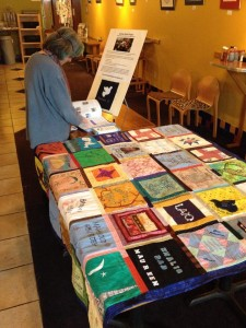 Drone quilt displayed on a table at an earlier drones quilts exhibit by Veterans for Peace
