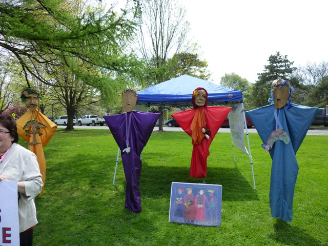 Four Guardian puppets with Ann Altman Poster and Dahlia in the foreground, photo by Marcia Hopple