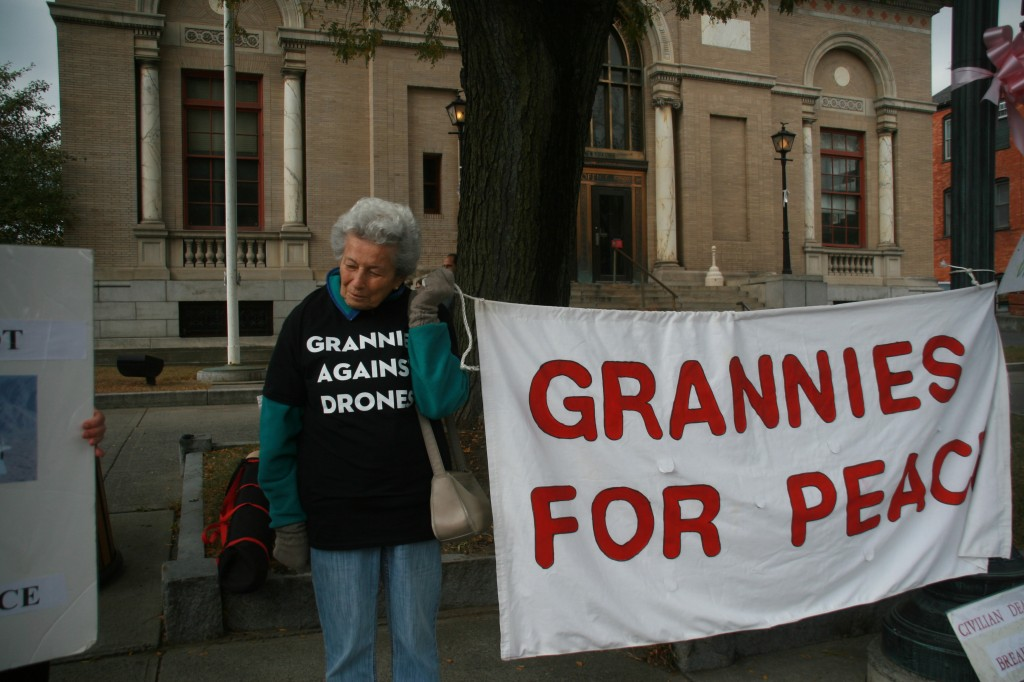 IMG_0799 Bertha holding up her end of the Grannies for Peace banner in Saratoga Springs