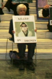 Pat Beetle with photo of Mamana Bibi 68 year old grandmother and  drone victim