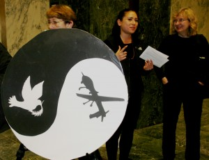 Joan, Mari and Trudy with Kim's beautiful yin - yang drone- dove poster