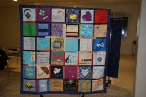 Quilts on frames at Empire State Plaza exhibit.