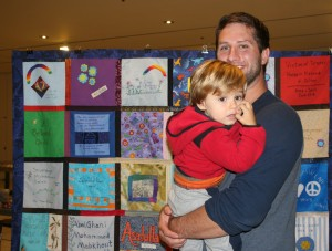 Father and son at the concourse exhibit on Thursday, 10/24/14