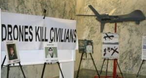 drones-kill-civilains-banner-and-model-drone-and-signs-photos-mabel