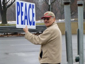 Doug with peace sign, photo by Marcia Hopple