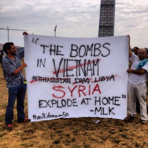 Sign by Syrian men in 2011, a Martin Luther King, Jr. Quote even more true today