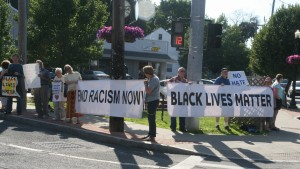 Grannies two banners at June 22 vigil at Delaware Avenue and Kenwood, photo by Mabel Leon
