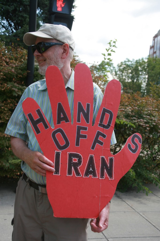 IMG_0512David Easter with Kims Hands off Iran sign, photo by Mabel