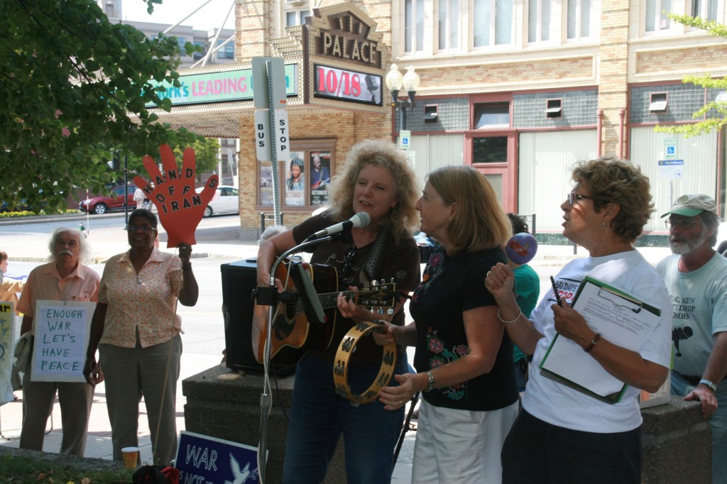 IMG_0592 Terri, Blue and Sue leading songs at the rally, photo by Mabel