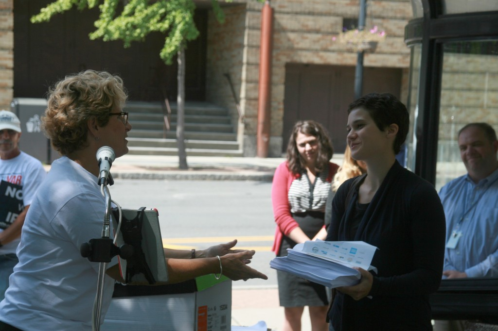 IMG_0684 Gia Recco of Sen. Gillibrands office receiving petitions whit Steve Mann in the background