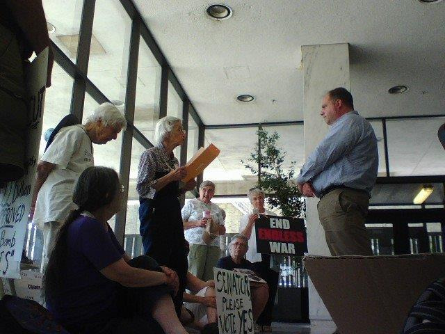 Sue Clark reading our letter to Steve Mann, Senator Schumer's Deputy State Director, photo by Wendy Dwyer