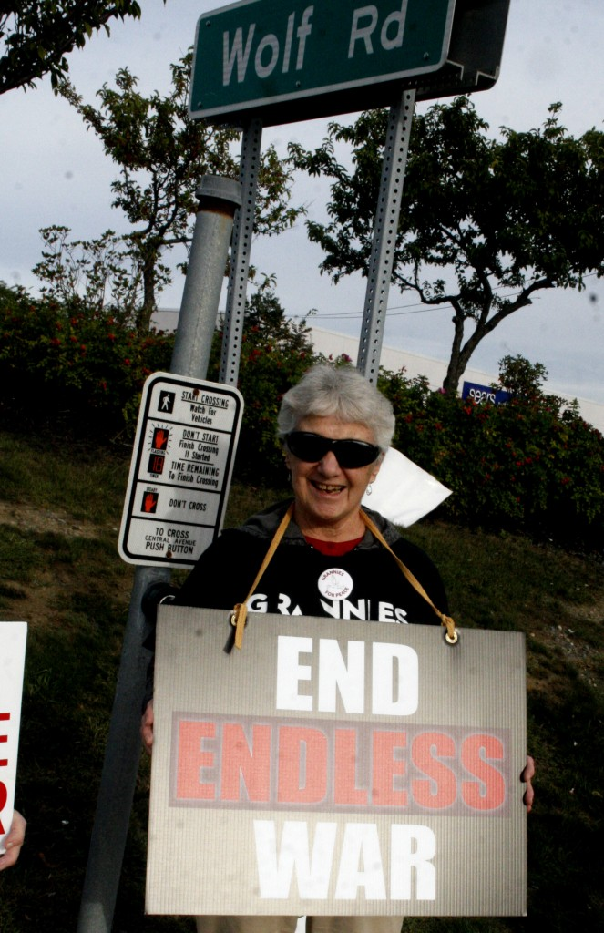 Doreen with one of the End Endless War signs that she created, photo by Mabel Leon