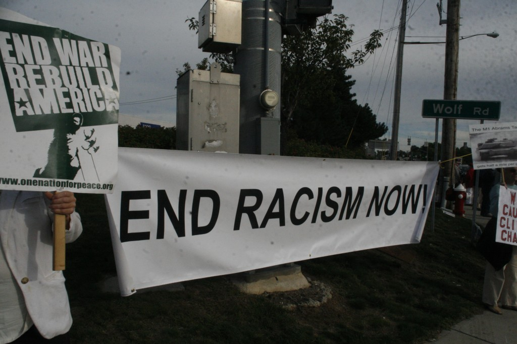 End Racism Now banner as part of the End Endless War message, photo by Mabel Leon