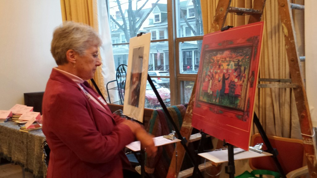 Doreen looking over the silent auction items, which Linda LeTendre auctioned with her usual humor and effectiveness!