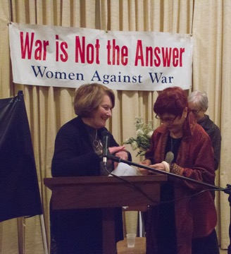 Mabel accepting the white rose of the Jose Marti poem, photo by Connie Frisbee Houde
