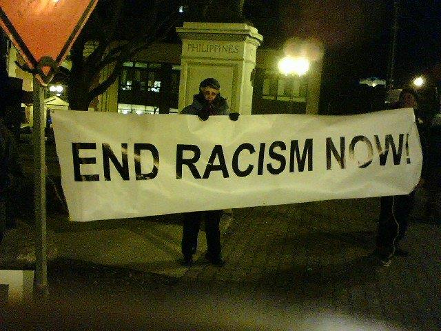 Grannies end racism now banner at JVP Chanukah vigil, photo by Wendy Dwyer