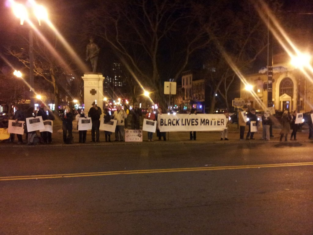 JVP vigil with Black Lives Matter banner from Women Against War, December 8, 2015