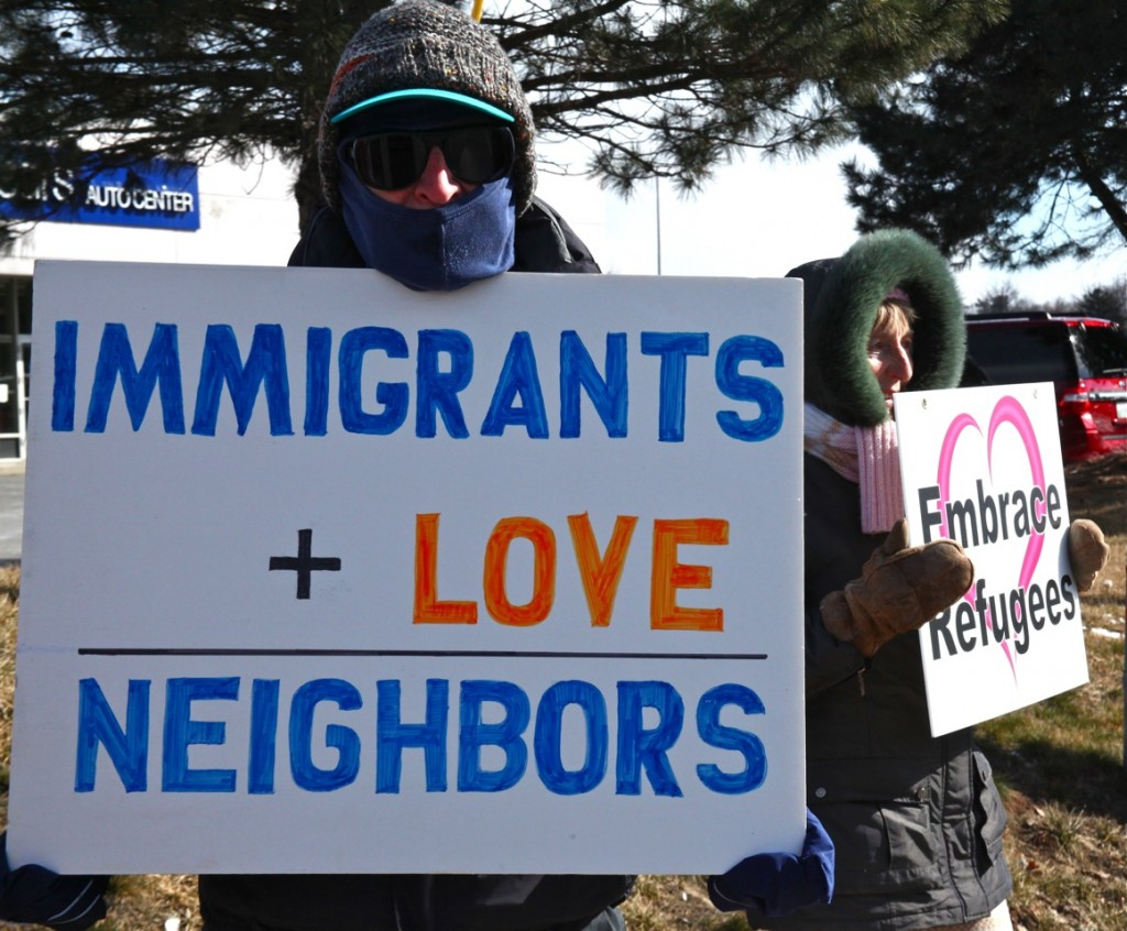 Immigrants plus love equal neighbors and Embrace Refugees, photo by Jeanne Finley