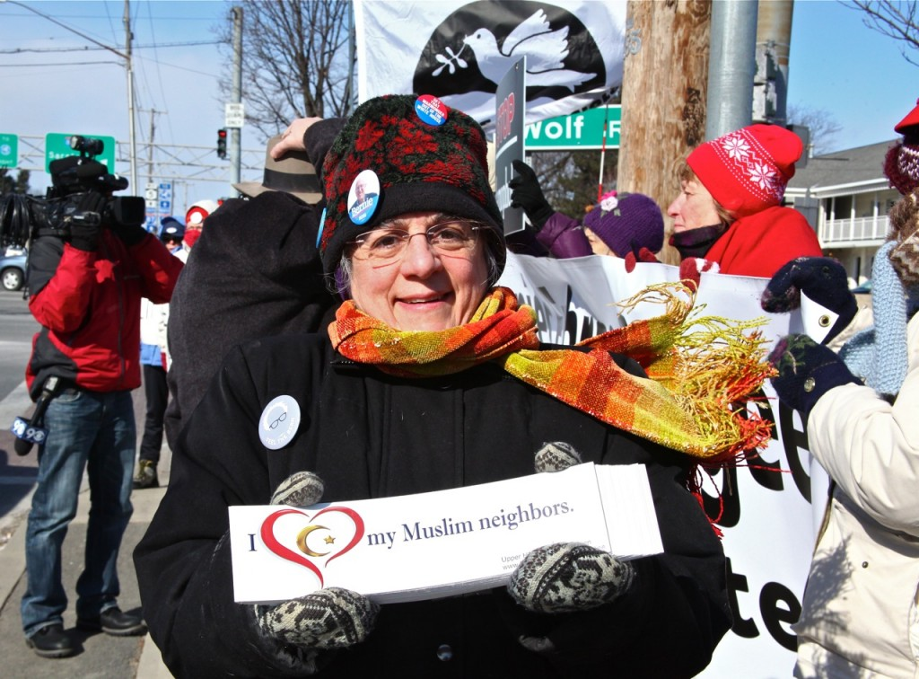 Valentines vigil, bumper sticker, cameraman, photo by Jeanne Finley