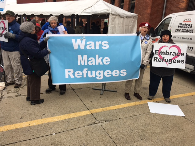 banner and signs outside Bernie Rally, April 11, 2016, photo by Mabel Leon