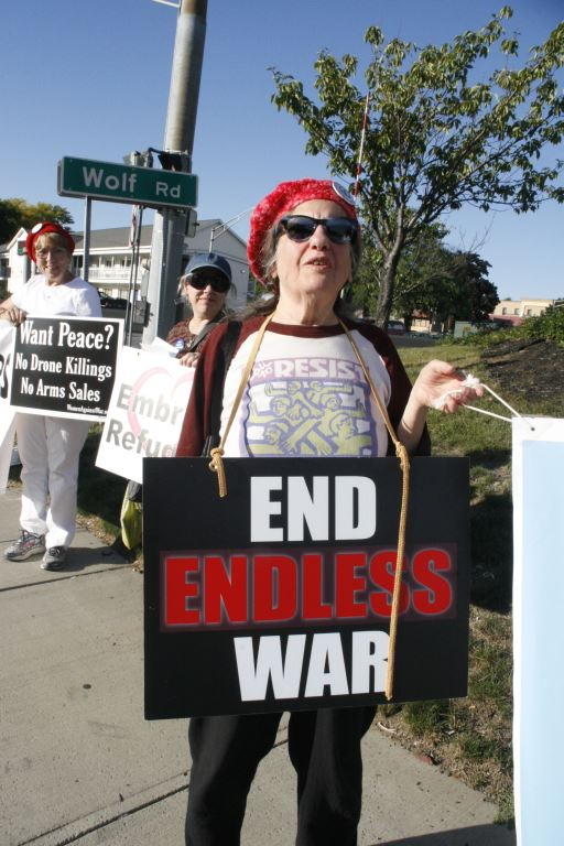 4 Mickie with End Endless War and holding half of Wars Make Refugees banner, 9-21-16,  Photo by Mabel Leon