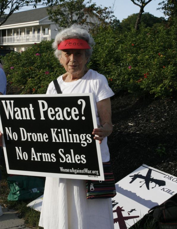 6 Bertha with yard sign and drones kill civilians in the background, photo by Mabel