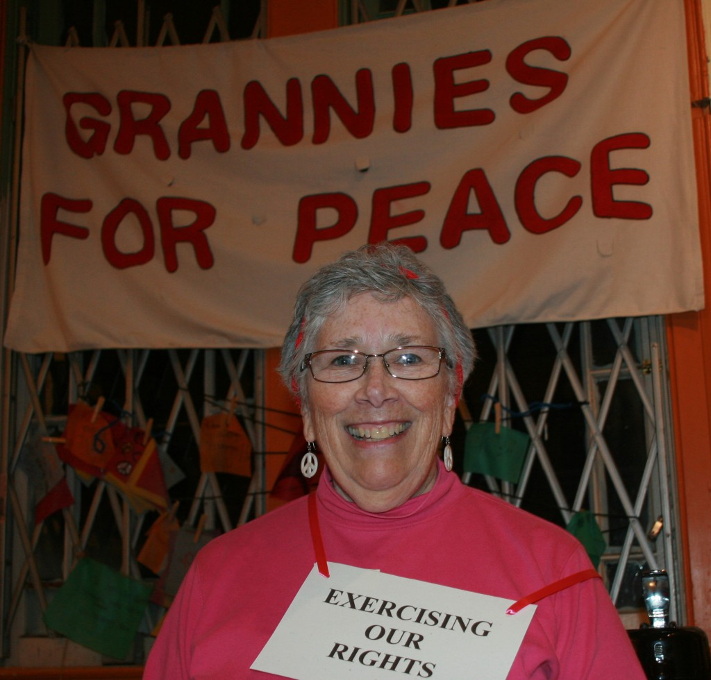 Anita at the Sanctuary with Grannies banner, photo by Mark Klein